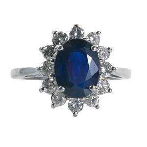 Sapphire and diamond princess ring oval faceted sapphire approx 285 cts surrounded by prong set rbc diamonds approx 60 ct tw in 14k wg topped mount engraved date on interior 214 1997 s