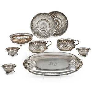 American and foreign ornamental silver holloware ten pieces four coin silver dishes with ball and paw feet unmarked international sterling bread tray in the danish style reticulated sterling bonb