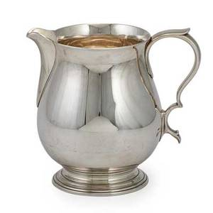 Tiffany  co sterling silver water pitcher bulbous form with scroll handle on spreading foot first half 20th c 7 x 8 330 ot
