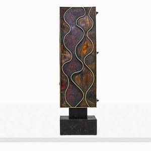 Paul evans 1931  1987 paul evans studio rare wavy front cabinet new hope pa 1971 welded and polychromed steel painted wood 23 carat gold leaf signed paul evans 71 84 x 25 x 21 12