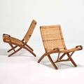 Style of hans wegner pair of folding lounge chairs denmark 1960s teak brass woven cord unmarked 31 x 23 12 x 30