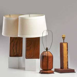 Jacques adnet attr two leather covered table lamps together with pair of oak and glass table lamp bases 20th c all unmarked tallest 21 x 6 12 dia