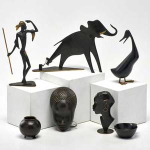 Hagenauer wien six pieces elephant duck two cabinet vases and two tribal pieces by richard rohac together with a similar mask vienna 20th c wood brass bronze all marked elephant 7 x 10