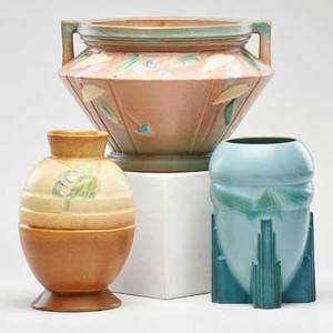 Roseville three pieces futura buttressed vase twohandled jardiniere and footed vase with floral design zanesville oh 1924 all unmarked tallest 8 14 x 5 dia