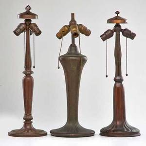 Handel etc three patinated metal table lamp bases meridan ct early 20th c two marked tallest 23 12
