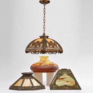 Arts and crafts slag glass chandelier with metal overlay and three lamp shades shades two slag glass with patinated metal overlay and one chipped glass painted with a dutch landscape chandelier