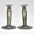 Liberty tudric pair of pewter candlesticks each decorated with enameled copper cabochons england ca 1900 stamped english pewter made in england 9 tall 6 dia