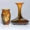Anne marie valentien 1862  1947 rookwood two standard glaze vases one decorated with violets and one with roses cincinnati oh 189194 both marked taller 7 12