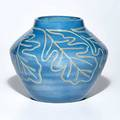 Julia mattson north dakota school of mines glazed ceramic vase incised with oak leaf decoration grand forks nd indigo stamp and incised artists cipher 6 14 x 6 12 dia