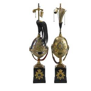English guard parade helmets one with emblem of prince of wales together with one that reads the royal dragoons late 19th early 20th c mounted as lamps 35 provenance estate of a private col
