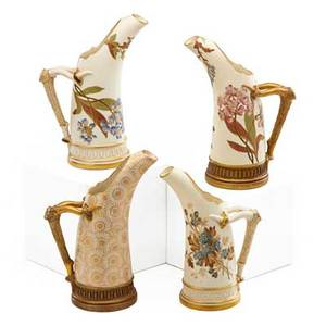 Royal worcester porcelain four pitchers with curved forms and molded antler form handles late 19thearly 20th c marked tallest 8 14