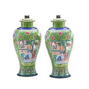 Pair of canton enameled vases depicting narrative figural scenes each with cobalt and gilt trim and foo dog finial late 19thearly 20th c 10 34