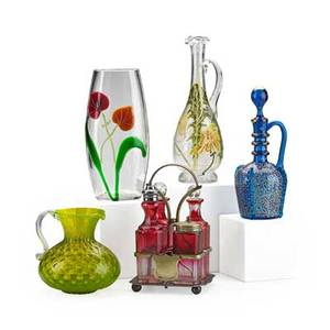 Group of art glass five pieces including cranberry glass castor set vaseline pitcher with applied handle blue glass enameled ewer floral enameled cruet and cylindrical vase with floral decoration