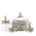 Kpm porcelain comprising three double salts and a circular tureen decorated with foliate vines and a finial molded as an infant holding a cornucopia germany 20th c printed marks tureen 10 34