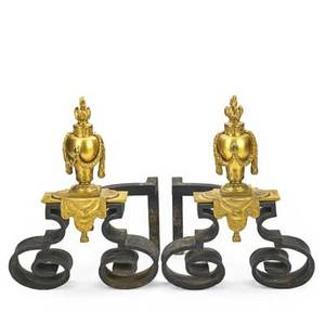 Pair of louis xv style chenets dore bronze mounted on cast iron bases continental 20th c 15 x 11 12 x 10 12