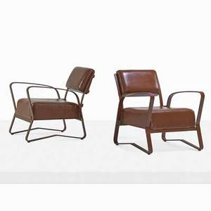 Jacques adnet 1901  1984 pair of lounge chairs france 1960s stitched leather brass unmarked 29 12 x 25 x 32