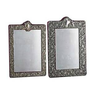 Two dominick and haff silver dressing mirrorsdecorated with birds entwined with foliate scrolls velvetbacked late 19th c larger 19 12 x 13 provenance estate of a private collector new