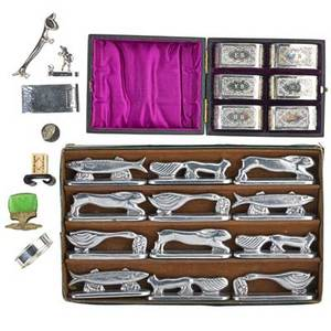 Placecard holders and napkin rings sixtyeight pieces collection of place card holders including twelve italian sterling cherubs six green glass intaglios six pewter daschunds seven bone and bamb