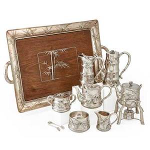 Japanese meiji period sterling tea and coffee service nine pieces modeled in the form of leafy bamboo stalks comprising teapot coffee pot hot water kettle on stand with burner warm milk pot cre