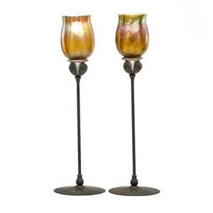 Tiffany studios pair of candlesticks new york 1900s gold favrile glass bronze sterling both stamped tiffany studios new york 3093 19 12 x 5 34