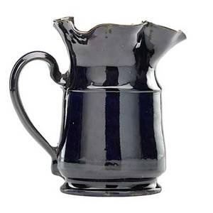 George ohr 1857  1918 large rare pitcher with ruffled rim indigo and green glaze biloxi ms 18981910 script signature 6 12 x 6 12