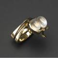 Albert paley rare and early interlocking ring set in yellow gold with two moonstone cabochons 1968