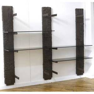 Paul evans sculpted bronze shelving unit with three wallmounted uprights in brown finish with smoked glass shelves 1969 signed pe 69 76 x 96 x 17 34