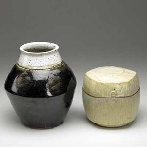 Warren mackenzie two pieces a pentagonal lidded glazed stoneware container and a stoneware vase covered in gray and black glazes with incised decoration both marked with artist cipher 10 14 x 10