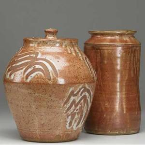 Warren mackenzie covered stoneware jar with glazed decoration and cylindrical vase covered in shino glaze each signed with artist cipher 10 14 x 10 dia 10 x 5 12 dia