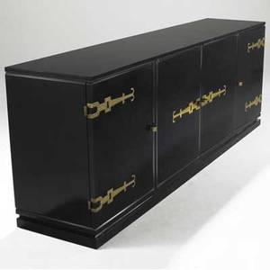 Tommi parzinger credenza in black lacquered finish with brass strap hinges and four doors enclosing shelves and divided drawers 34 x 96 x 21
