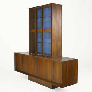 Vladimir kagan walnut cabinet with blue painted details three glassfront doors enclosing glass shelves on sideboard with three pairs of doors enclosing interior drawer and shelves 87 x 84 x 22