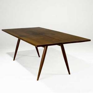 George nakashima turned leg dining table the twopiece walnut top with three rosewood butterfly keys on splayed legs provenance available 28 34 x 84 x 40