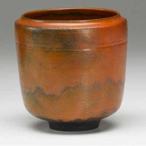 Natzler cylindrical footed ceramic vessel covered in orange uranium glaze signed natzler 5 14 x 5