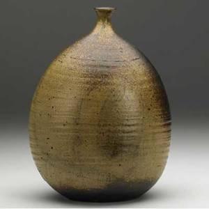 Toshiko takaezu stoneware bottle covered in mottled brown glazes signed tt 10 x 7 x 5