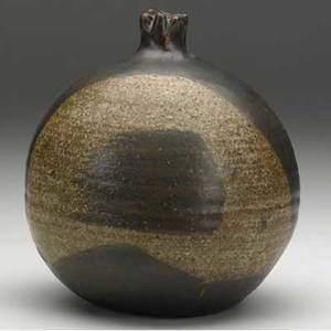 Toshiko takaezu stoneware bottle with fluted rim covered in mottled brown glazes signed tt 7 x 6 x 5 12