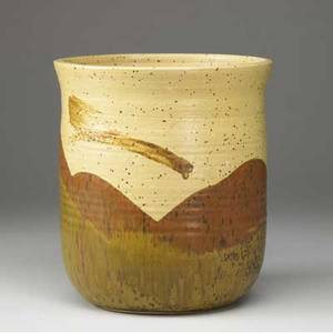 Toshiko takaezu stoneware vessel covered in brown and cream tonal glazes signed tt 10 x 8 34