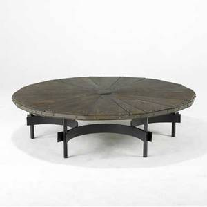 Harry balmer  flemington iron works large circular coffee table its radiating oak top with riveted steel trim over a black enameled steel base 16 x 60 dia