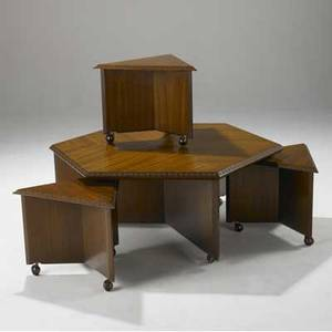 Frank lloyd wright  henredon ribbon mahogany coffee table with bookmatched veneer and taliesin carving en suite with three triangular stools on casters signed 19 x 48 x 48 and 16 12 x 22 x
