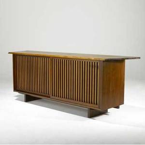 George nakashima walnut sideboard with two grilled sliding doors backed in pandanus cloth enclosing three drawers and two shelves provenance available 32 x 90 x 21