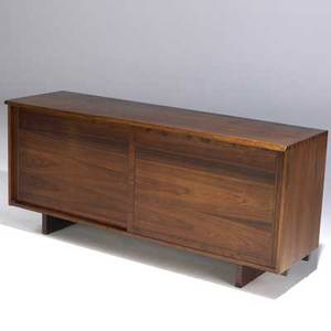 George nakashima walnut cabinet with freeedge top dovetailed case and two sliding doors enclosing interior drawers and shelves provenance available 32 x 72 x 22