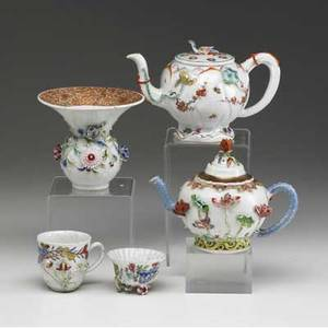 Chinese export five pieces includes two teapots a vase and two cups all with figural or flower relief decoration 18th c vase repaired tallest 4 12