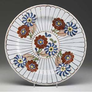 Delft polychrome charger with floral decoration 18th c hairline 13 14 dia