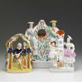 Staffordshire three figurines includes watch hutch lute player and a double figure spill vase 19th c tallest 12 12