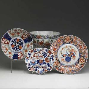 Japanese porcelain mixed lot of four pieces includes three imari design bowls one charger and an early polychrome deep bowl with stapled repairs largest 5 12 x 10 12