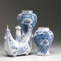 Delft two vases together with a bottle possibly for wine 18th c tallest 8