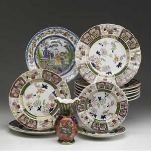 English ironstone twelve pieces of masons ironstone ten matching plates one vase and an oriental design plate mid 19th c tallest 6 12