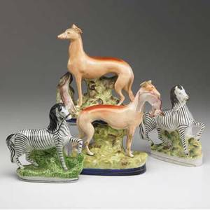 Staffordshire pair of zebra figurines together with a pair of hounds 19th c repairs to hounds taller 10 12