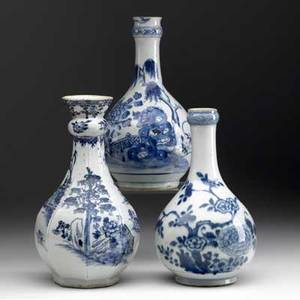 Chinese export grouping of three blue and white water bottles all with floral decoration 19th c tallest 10