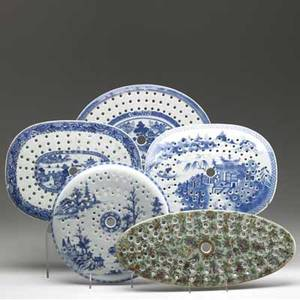 Chinese export grouping of five trivets four blue and white and one famille verte 19th c largest 16 x 7