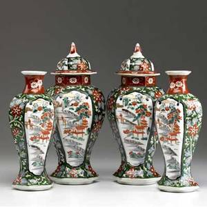 Chinese export fourpiece garniture set with floral decoration and front reserves depicting landscape 19th c tallest 12
